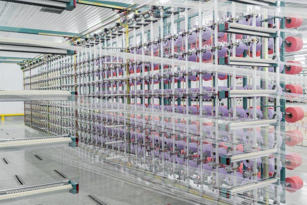 Yarn on a textile processing machine.